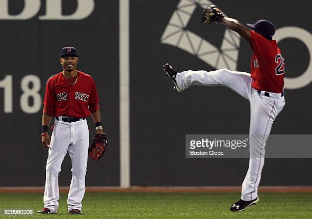 Boston Red Sox center fielder Mookie Betts and Boston Red Sox right fielder Jackie Bradley Jr. Celebrate the 7-5 win with a punt of their gum. The...