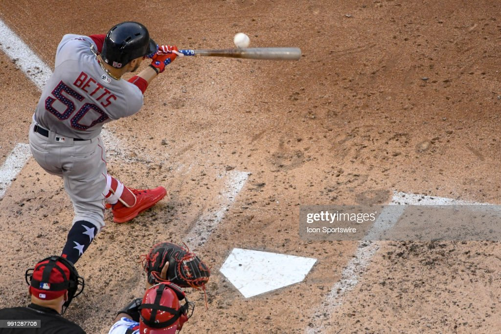 Boston Red Sox center fielder Mookie Betts (50) hits a fifth inning single during the game between the Boston Red Sox and the Washington Nationals on July 3, 2018, at Nationals Park, in Washington D.C.
