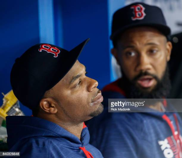 Boston Red Sox center fielder Rajai Davis listens to teammate Boston Red Sox left fielder Chris Young in the dug out Toronto Blue Jays Vs Boston Red...