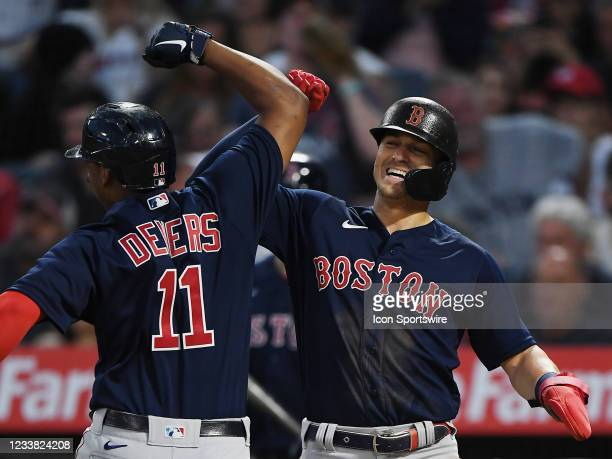 Boston Red Sox centerfielder Enrique Hernandez greets third baseman Rafael Devers at the plate after Devers hit a two run home run in the fourth...