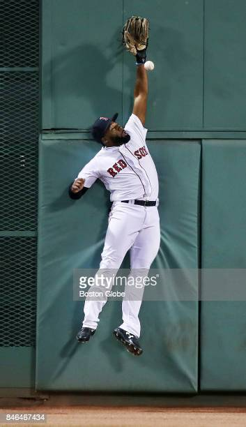 Boston Red Sox centerfielder Jackie Bradley Jr leaps and slams into the wall but can't catch a top of the first inning RBI double by the Athletics'...