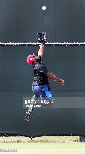Boston Red Sox centerfielder Jackie Bradley Jr leaps for a fly ball during a workout at spring training at the Player Development Complex at Jet Blue...