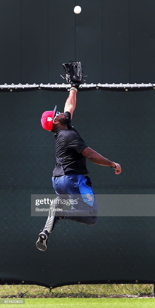 Boston Red Sox centerfielder Jackie Bradley, Jr. leaps for a fly ball during a spring training workout at the Player Development Complex at Jet Blue Park in Fort Myers, FL on Feb. 12, 2018.