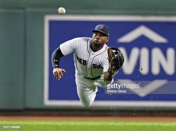 Boston Red Sox centerfielder Jackie Bradley Jr makes a diving catch to rob the Orioles' Caleb Joseph of a hit in the top of the eighth inning The...