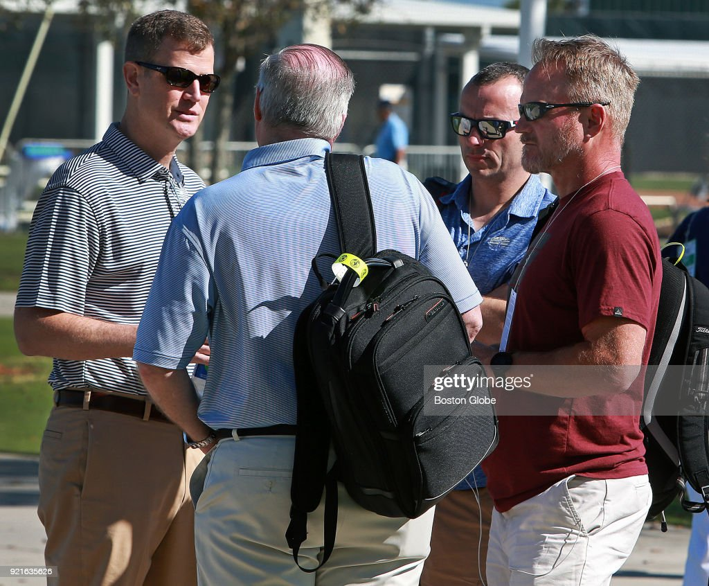 Boston Red Sox CEO Sam Kennedy, left, talks with WEEI morning drive talk show hosts Kirk Minihane, second from right, and Gerry Callahan, far right, on the day of the first full squad spring training workout at the Player Development Complex at Jet Blue Park in Fort Myers, FL on Feb. 19, 2018.