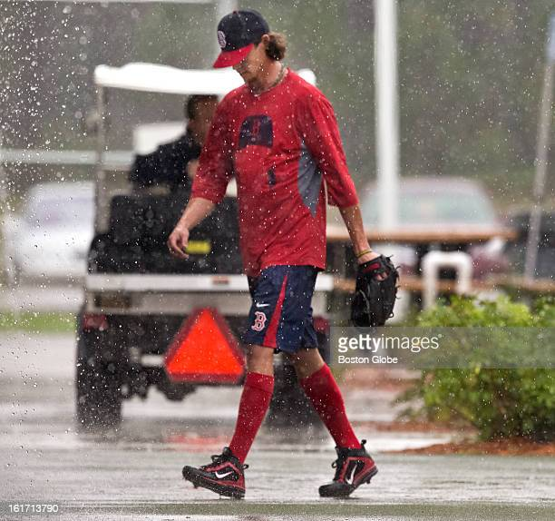 Boston Red Sox Clay Buchholz walks from the batting cage back to their clubhouse after practice at their training facilities at JetBlue Park on...