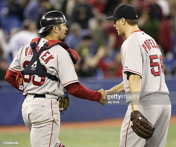 Boston Red Sox closer Jonathan Papelbon is congratulated by C Jason Varitek after Papelbon recorded his 4th save in the Red Sox 53 victory over the...
