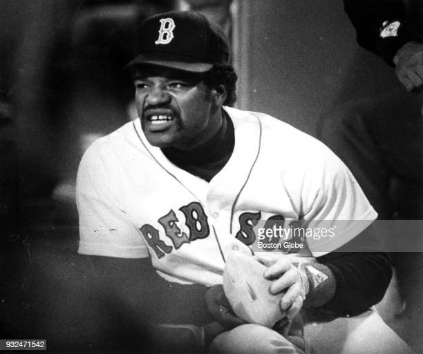 Boston Red Sox Dave Henderson warms his hands with a hot water bottle during the seventh game of the ALCS against the California Angels at Fenway...