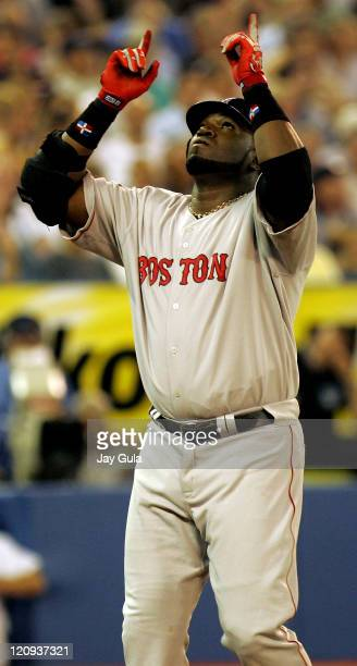 Boston Red Sox David Ortiz points skyward after slugging his 39th HR tonight in action at Rogers Centre in Toronto on September 12 2005