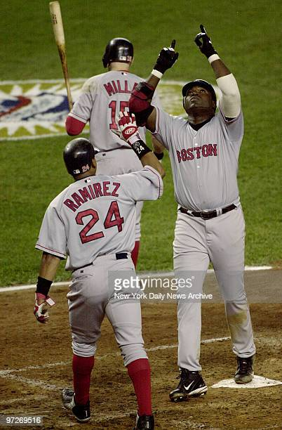 Boston Red Sox' David Ortiz points skyward upon reaching home plate Ortiz' tworun home run brought in runner Manny Ramirez and put the score at 20 in...