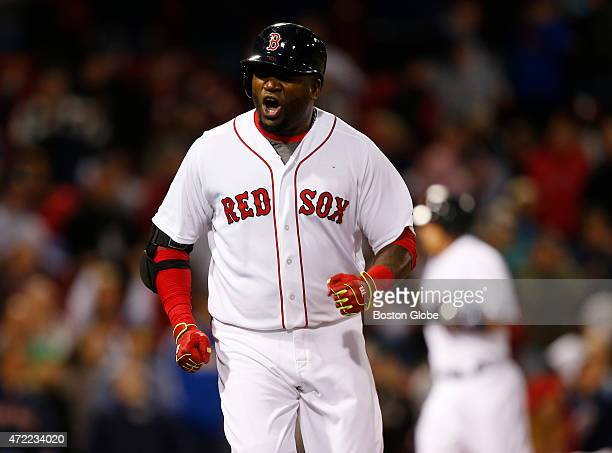 Boston Red Sox David Ortiz reacts after flying out with the bases loaded against the New York Yankees during the ninth inning at Fenway Park in...
