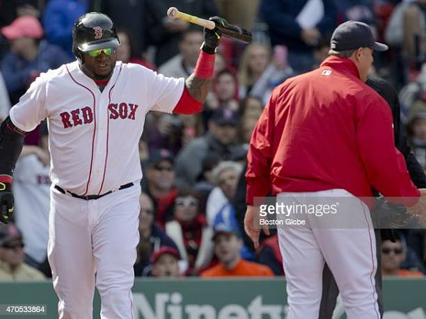 Boston Red Sox David Ortiz slams his bat down after he was thrown out of the game by home plate umpire John Tumpane as manager John Farrell argues...