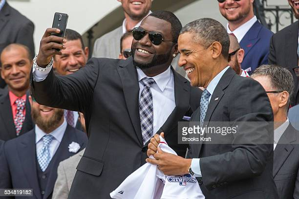 Boston Red Sox designated hitter David Big Papi Ortiz takes a selfie with President Barack Obama holding a Boston Red Sox jersey presented to him...