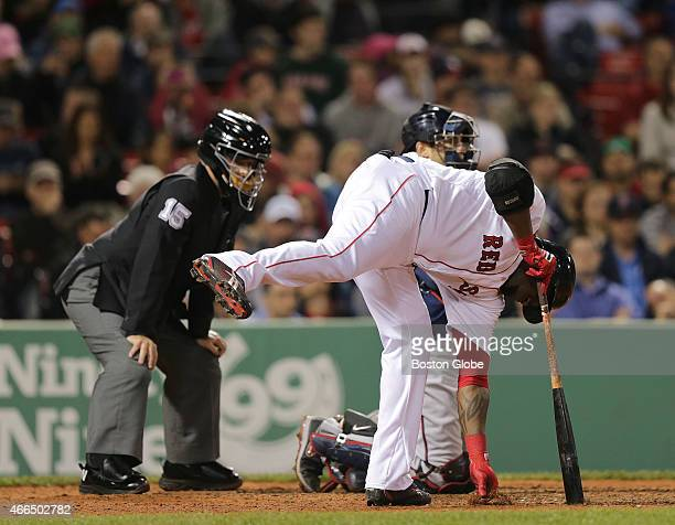 Boston Red Sox designated hitter David Ortiz begins his ritual of calling for time out gathering dirt spitting into his gloves rewrapping and...