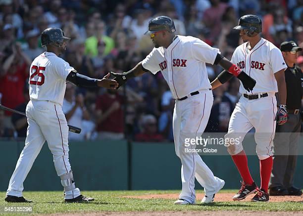 Boston Red Sox designated hitter David Ortiz, center, celebrates with center fielder Jackie Bradley Jr. After Ortiz and shortshop Xander Bogaerts...