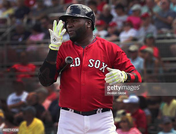 Boston Red Sox designated hitter David Ortiz goes through his usual routine of spitting into his batting gloves between pitches but Ortiz did not...