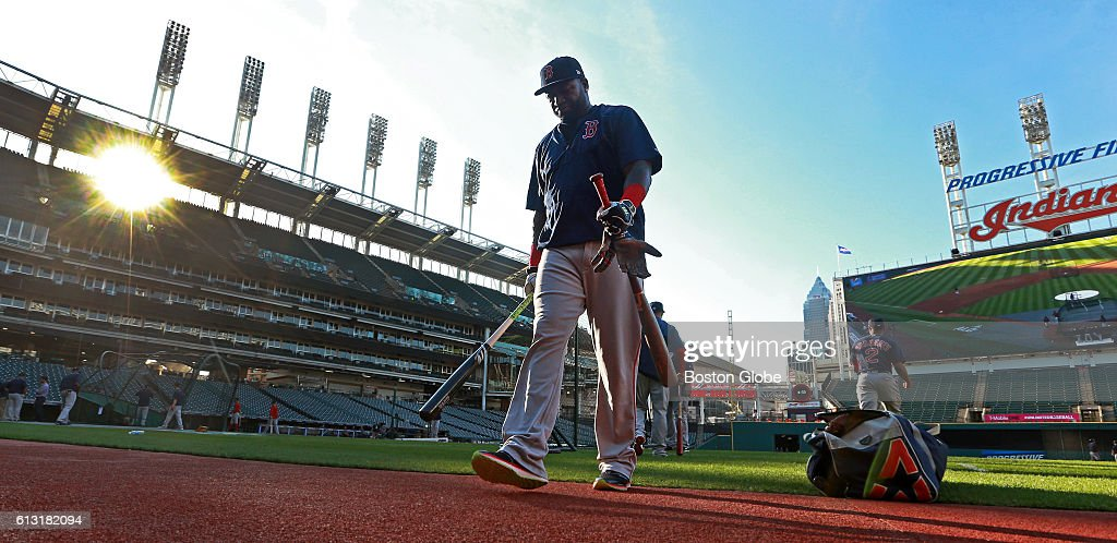 Boston Red Sox designated hitter David Ortiz heads for the clubhouse after taking batting practice as the sun sets behind the stadium. The Boston Red Sox held a workout at Progressive Field in Cleveland on Oct. 5, 2016, ahead of Thursday's first game of an American League Division Series.