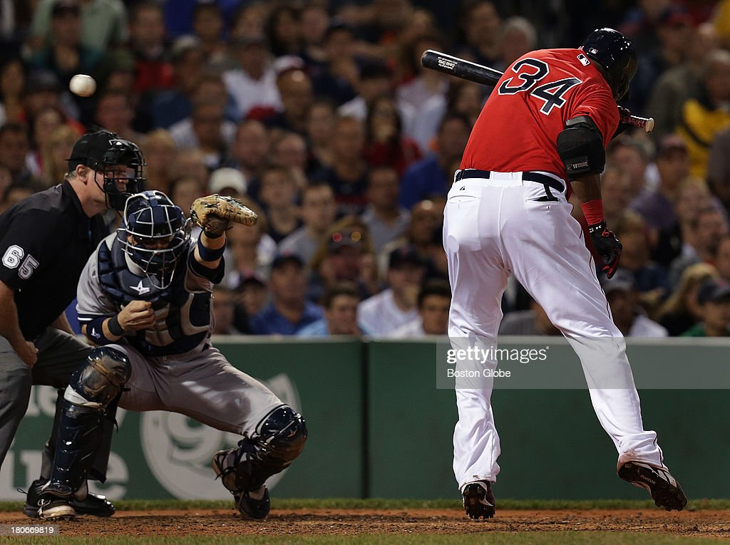 Boston Red Sox designated hitter David Ortiz (#34) is struck by a pitch in the seventh inning. The Boston Red Sox take on the New York Yankees in Game one of a three game series at Fenway Park.