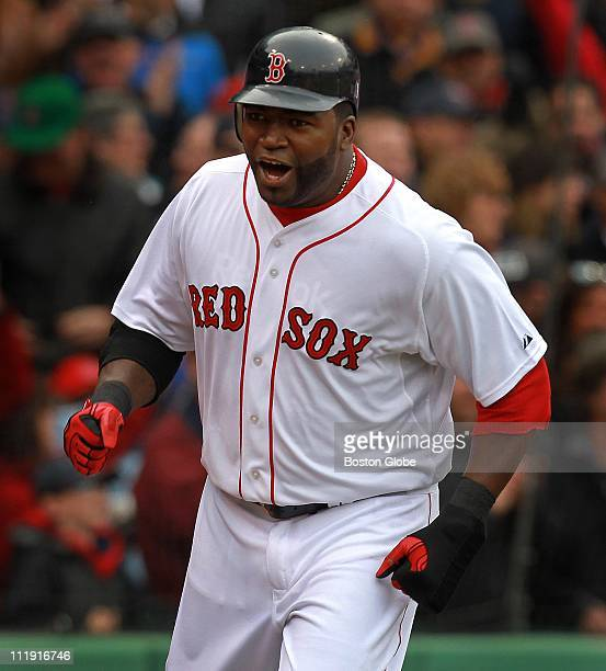 Boston Red Sox designated hitter David Ortiz lets out a howl as he heads for the dugout after scoring on a single by Boston Red Sox right fielder JD...