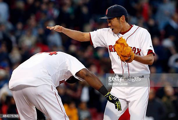 Boston Red Sox designated hitter David Ortiz picks up Red Sox closing pitcher Koji Uehara right as they celebrate their win against the Texas Rangers...