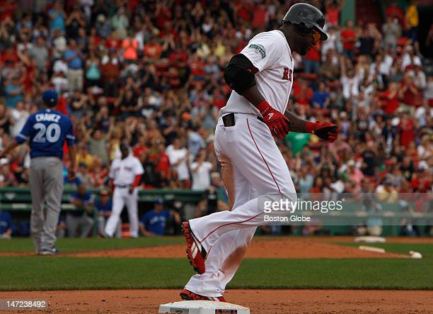 Boston Red Sox designated hitter David Ortiz rounds first base on the way to touching them all after his solo homer in the fifth inning as the Boston...