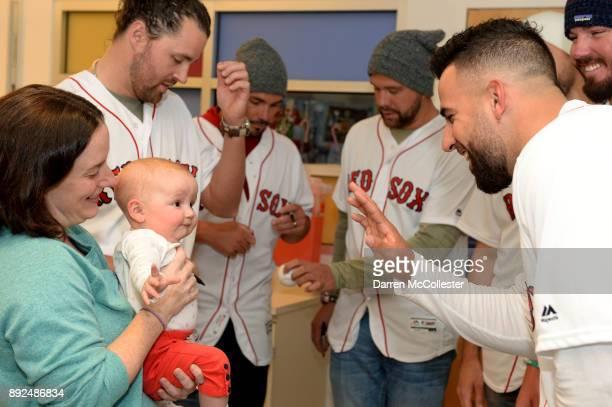 Boston Red Sox Devin Marrero says hi to Gabriella and her mom at Boston Children's Hospital December 14 2017 in Boston Massachusetts