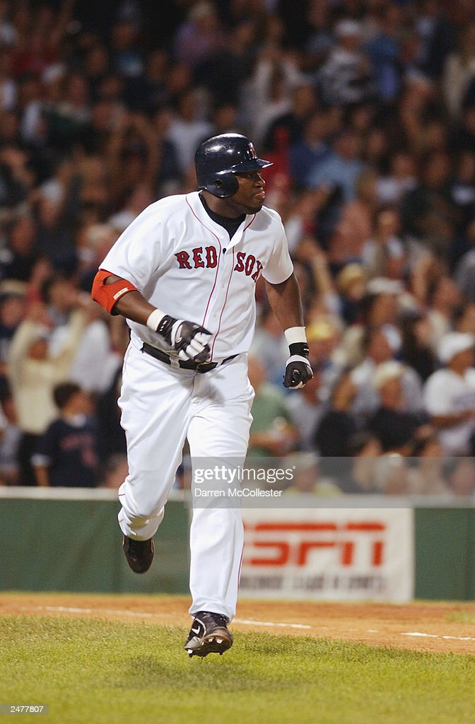 Boston Red Sox DH David Ortiz #34 watches as his 4th inning 3 run homer goes out of the park during the game against the Seattle Mariners at Fenway Park August 24, 2003 in Boston, Massachusetts. The Red Sox won 6-1 further tightening the race in the American League east.