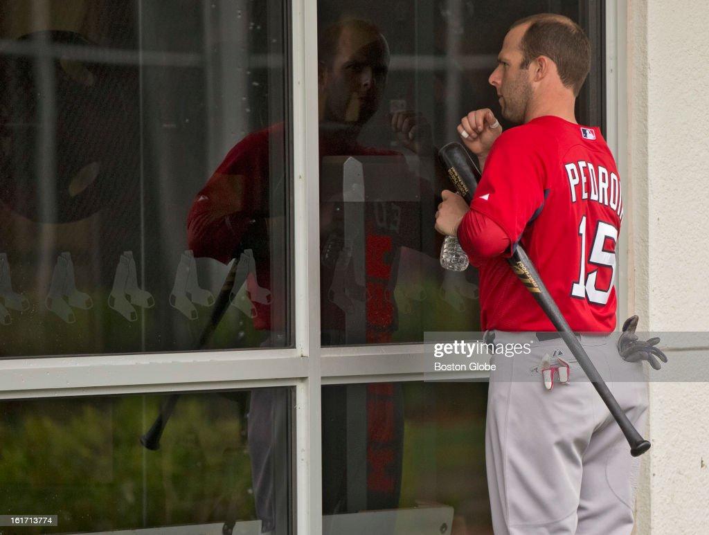 Boston Red Sox Dustin Pedroia knocks on the window of their weight room to unlock the door. Day three of spring training at the Red Sox training facilities at JetBlue Park on Thursday, Feb. 14, 2013.