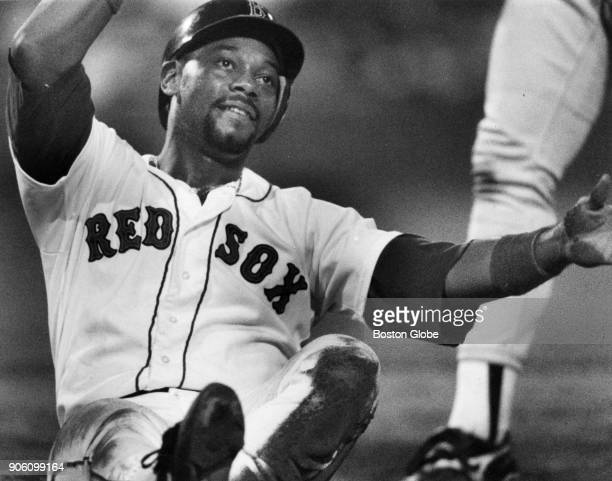 Boston Red Sox Ellis Burks slides into first base during a game against the Chicago White Sox at Fenway Park in Boston July 27 1991