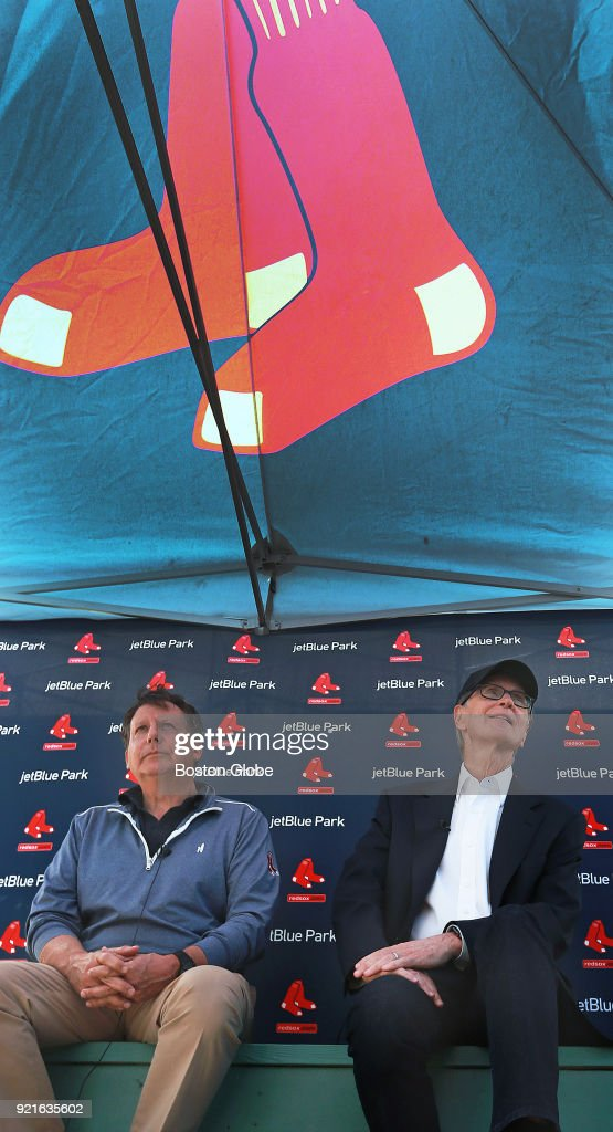 Boston Red Sox executives Tom Werner, left, and John Henry meet with the media under a tent outside the clubhouse on the day of the first full squad spring training workout at the Player Development Complex at Jet Blue Park in Fort Myers, FL on Feb. 19, 2018.