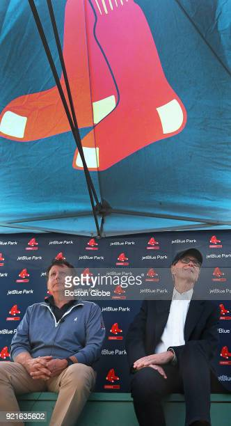 Boston Red Sox executives Tom Werner left and John Henry meet with the media under a tent outside the clubhouse on the day of the first full squad...