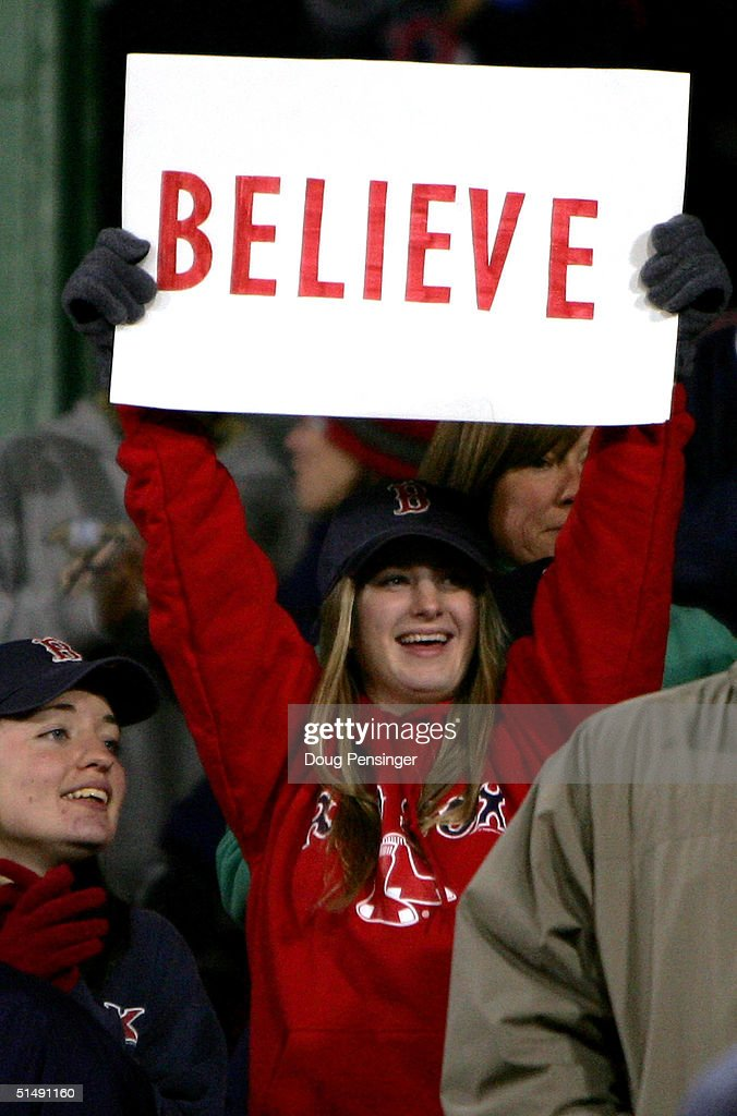 A Boston Red Sox fan holds up a sign that reads 'Believe' after David Ortiz #34 hit the game winning two-run home run against the New York Yankees in the twelth inning to win game four 6-4 during the American League Championship Series on October 17, 2004 at Fenway Park in Boston, Massachusetts.