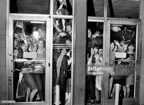 Boston Red Sox fans await the return of the team at Logan International Airport in Boston on Oct 9 after game 5 win in St Louis