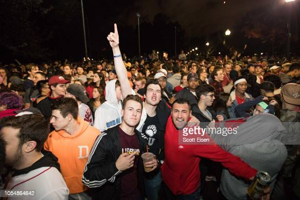 Boston Red Sox fans celebrate after the team beat the Los Angeles Dodgers for the World Series title during Game 5 on October 28 2018 in Boston...