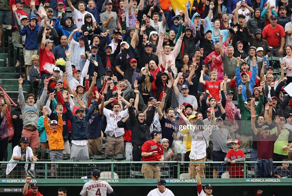 Boston Red Sox fans cheer after a first inning solo home run by Xander Bogaerts #2 of the Boston Red Sox (not pictured) during game four of the American League Division Series between the Houston Astros and the Boston Red Sox at Fenway Park on October 9, 2017 in Boston, Massachusetts.