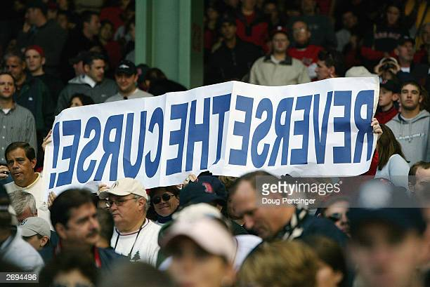 Boston Red Sox fans hold up a sign reading 'Reverse the Curse' during game four of the American League Division Series against the Oakland Athletics...