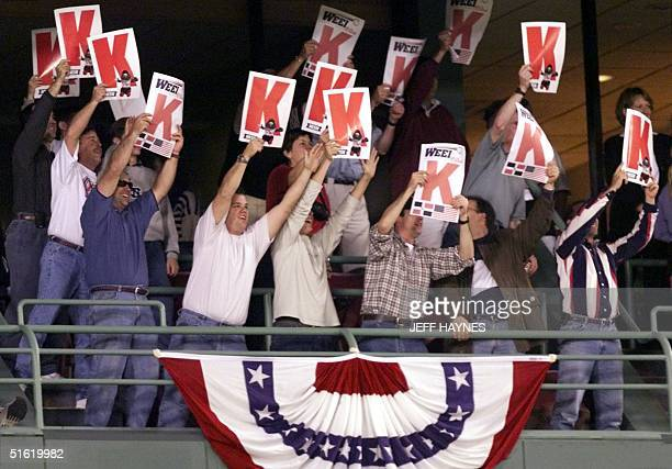 Boston Red Sox fans hold up posters bearing K's symbolizing a strike out for starting pitcher Pedro Martinez who finished the game with a total of 12...