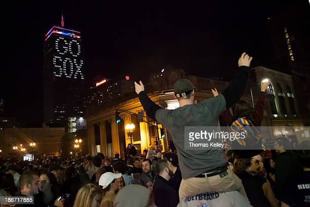 CONTENT] Boston Red Sox fans rally in the middle of the intersection at Massachusetts Ave and Boylston St Many of those stuck in traffic ended up...