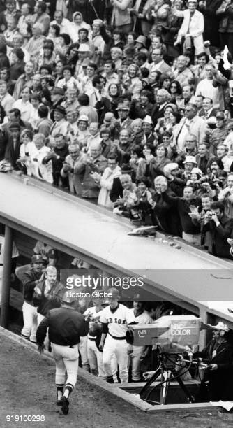 Boston Red Sox fans react to Luis Tiant scoring during a world series game against the Cincinnati Reds at Fenway Park in Boston Oct 11 1975