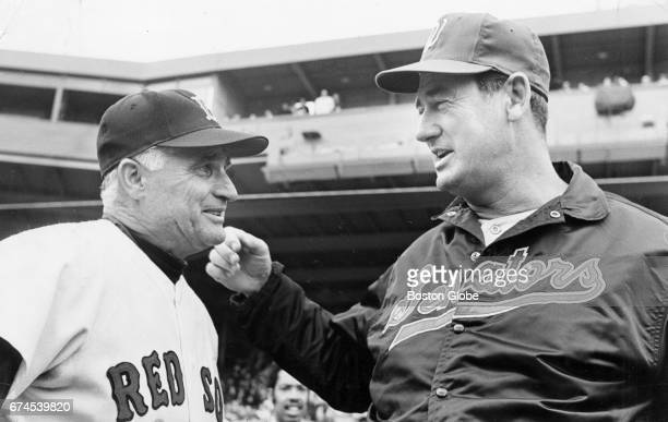 Boston Red Sox first base coach Bobby Doerr left talks with former teammate Ted Williams at Fenway Park in Boston on Apr 23 1969