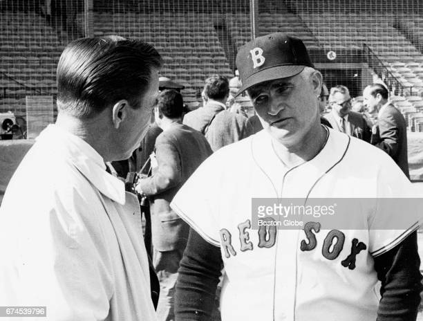 Boston Red Sox first base coach Bobby Doerr right talks with former baseball player PeeWee Reese on the day of Game Six of the 1967 World Series at...