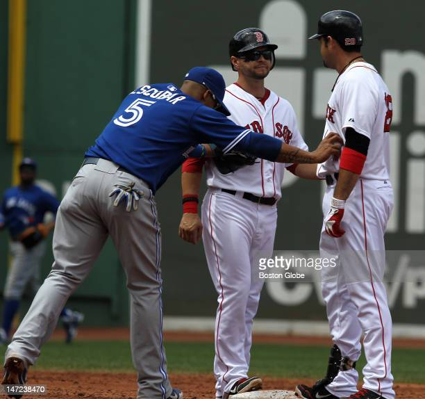 Boston Red Sox first baseman Adrian Gonzalez was the odd man out after he and Boston Red Sox right fielder Cody Ross ended up on second base at the...