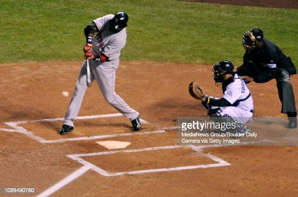 Boston Red Sox first baseman David Ortiz hits an RBI single in the first inning off Colorado Rockies starting pitcher Aaron Cook during World Series...