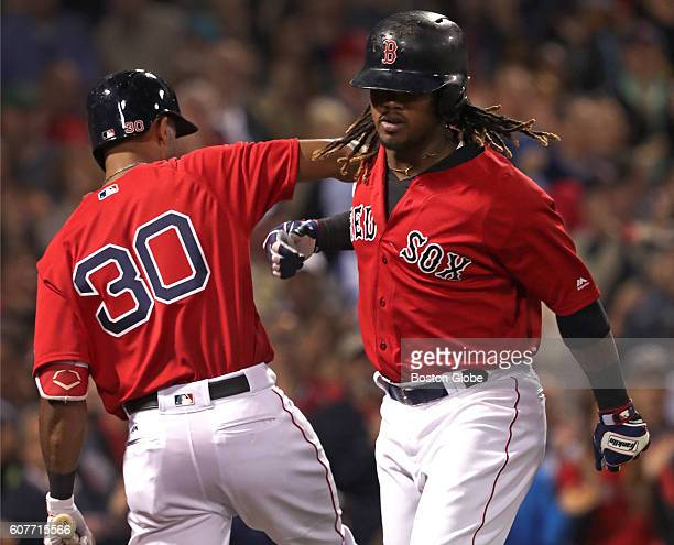 Boston Red Sox first baseman Hanley Ramirez celebrates with Boston Red Sox left fielder Chris Young after Ramirez's solo home run during the fourth...