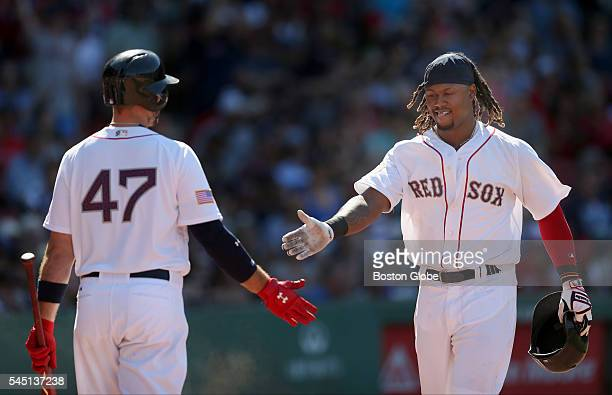 Boston Red Sox first baseman Hanley Ramirez, right, celebrates with third baseman Travis Shaw after Ramirez scored from a ground-rule double by...