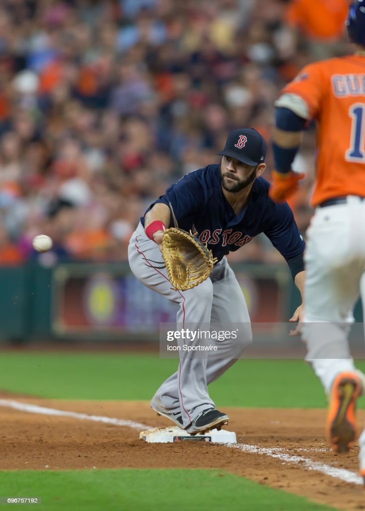 Boston Red Sox first baseman Mitch Moreland (18) makes an out at first base during the MLB game between the Boston Red Sox and Houston Astros on June 16, 2017 at Minute Maid Park in Houston, Texas.