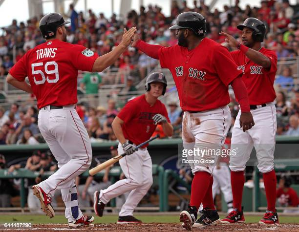 Boston Red Sox first baseman Sam Travis is congratulated by Boston Red Sox third baseman Pablo Sandoval and Boston Red Sox outfielder Chris Young who...