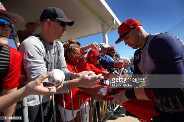 Boston Red Sox first baseman Steve Pearce signs autographs for fans while Boston Red Sox pitchers and catchers work out at JetBlue Park in Fort Myers...