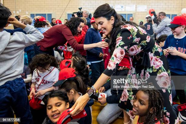 Boston Red Sox Foundation Board Member Linda Pizzuti Henry distributes hats to students hat donation event at the Hurley School on April 4 2018 in...