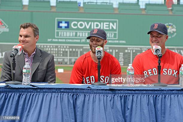 Boston Red Sox General Manager Ben Cherington left and Manager John Farrell announce a an eight year contract with second baseman Dustin Pedroia...